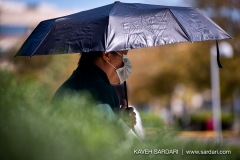 A man protects himself from the sun while waiting in line to vote early in Fairfax, Virginia